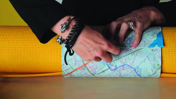 gift wrapping a yoga mat with a map